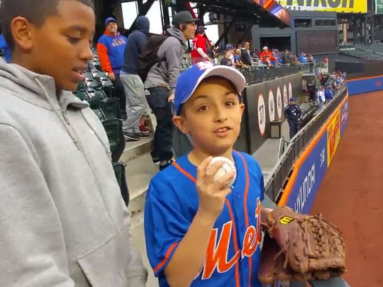 The 11-year-old fan after his game of catch with Max Scherzer.