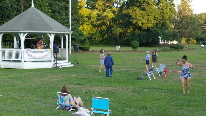 A dancing, hula-hooping, socially distanced crowd turned out Aug. 5 to hear Rampage Trio, part of the Sterling Summer Concert series.
