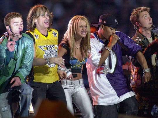 Singer Britney Spears, flanked by Steven Tyler of Aerosmtih, second from left, and hip-hop star Nelly, second from right, join  'N Sync members Justin Timberlake, far left, and Lance Bass, far right on stage for the halftime show of Super Bowl XXXV on Sunday, Jan. 28, 2001, in Tampa, Fla.