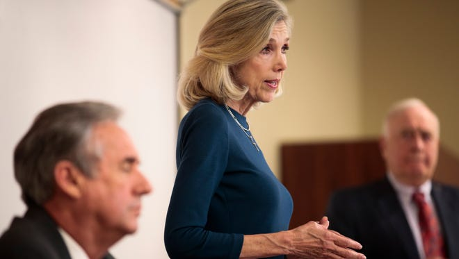 In this Sept. 26, 2016, file photo, State District Judge Marilyn Castle and Appellate Court Judge Jimmy Genovese, debate at the University of Louisiana at Lafayette.