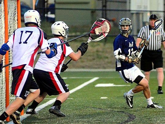 4-13 Hendersonville-JPII lacrosse 8783.JPG