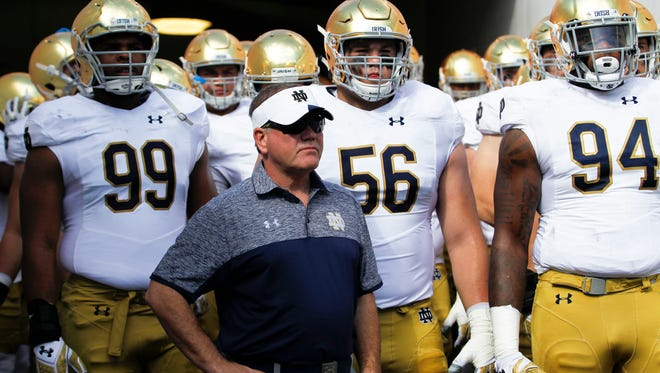 Nov 5, 2016; Jacksonville, FL, USA; Notre Dame Fighting Irish head coach Brian Kelly leads his team out to the field prior to a game against the Navy Midshipmen at Everbank Field. Mandatory Credit: Logan Bowles-USA TODAY Sports