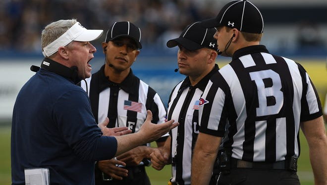 Nevada head coach Brian Polian speaks with officials during a break in the action at Mackay Stadium.