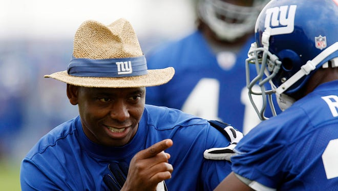 Jun 16, 2009; East Rutherford, NJ, USA;  New York Giants safeties coach David Merritt instructs New York Giants player Sha'reff Rashad (30) at mini camp at Giants Stadium. Mandatory Credit: William Perlman/THE STAR-LEDGER via USA TODAY Sports