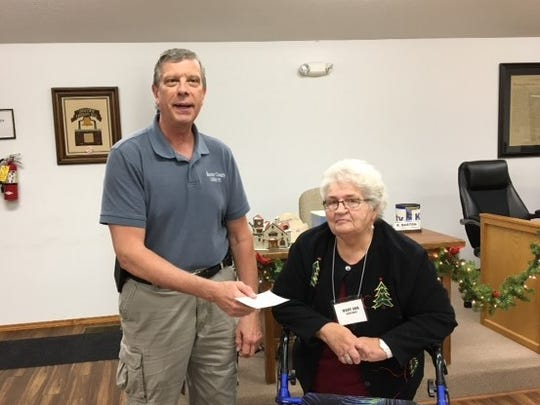 At the Lakeview Community Club's Dec. 4 Christmas dinner, checks for $13,400 were presented by club presidentMary Ann Kanturek to both Lakeview Mayor Dennis Behling (top photo) and Grover Township Fire Chief JimSierzchula (bottom photo). The donations were made possible by the sale of the club's building located on Hwy. 178 W.The Lakeview Community Club is a 401(c) 4 organization that meets on the first Monday of each month, except for January and February, at 6 p.m. at Lakeview City Hall.
