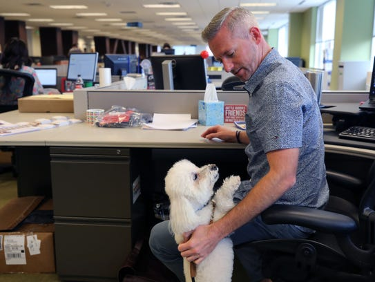 Tim Wingard gives some attention to his dog, which