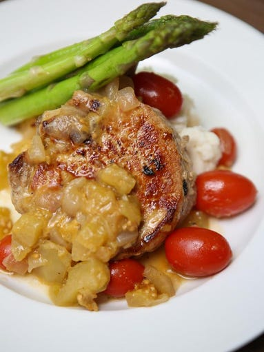 The Rosemary and Lemon brined Pork Chop at Coach Lamp's served with ...