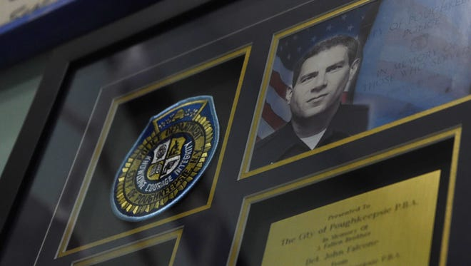 A closeup of one of the memorial plaques dedicated to Det. John Falcone of the City of Poughkeepsie Police Dept., who died in the line of duty in 2011.