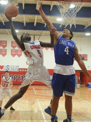 Cooper's Matthew Falade (5) drives to the basket as