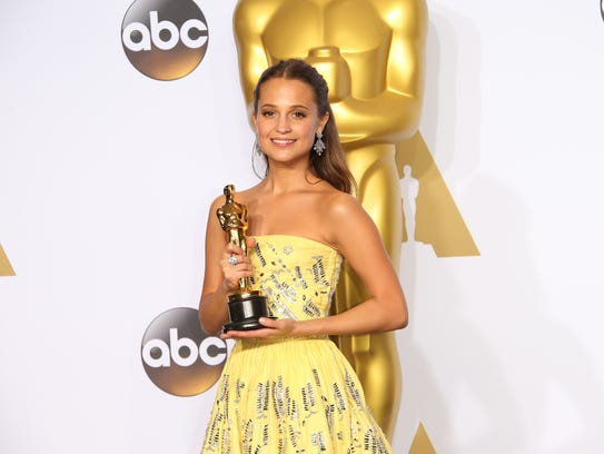 Alicia Vikander poses in the trophy room with her supporting