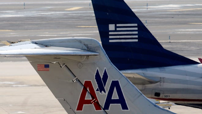 American Airlines and US Airways jets at the Philadelphia International Airport on Feb. 14, 2013.