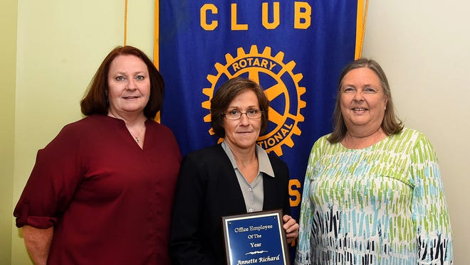 The Opelousas Rotary Club's Office Employee of the Year was awarded to Annette Richard of St.Landry Homestead. The presentation was made Tuesday at the Rotary Club's weekly luncheon. Pictured with Richard, center, is Cindy Veillon, left, who nominated Richard, and Susan Litton, Opelousas Rotary Club representative.