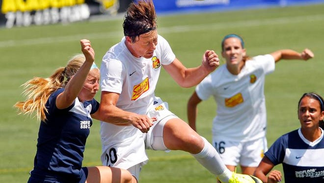 The Flash's Abby Wambach, right, outleaps Sky Blue's Kendall Johnson for a header.