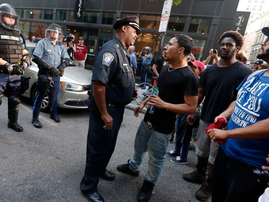 "Boston Police Superintendent In Chief William Gross, center, talks with counterprotesters, part of a small group who remained on the street hours after a ""Free Speech"" rally was staged by conservative activists Saturday in Boston."