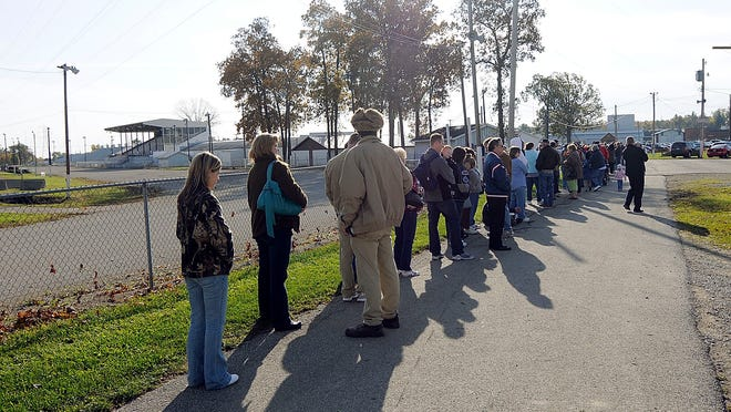 In this 2009 photo, hundreds of people wait in line outside Mozelle Hall at the Ashland County Fairgrounds for the H1N1 vaccine clinic.