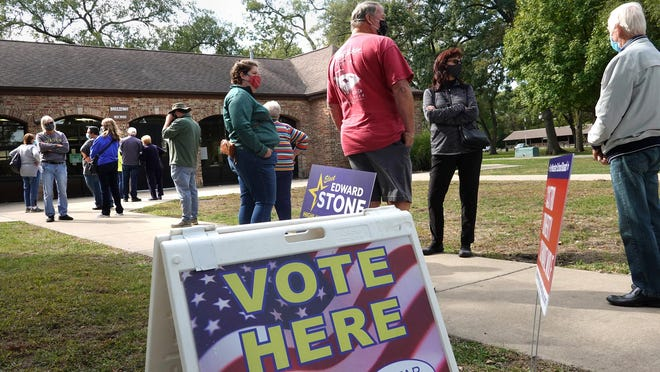 Residents wait in line to vote at the Wicker Park Social Center on Oct. 6 in Highland, Indiana.
