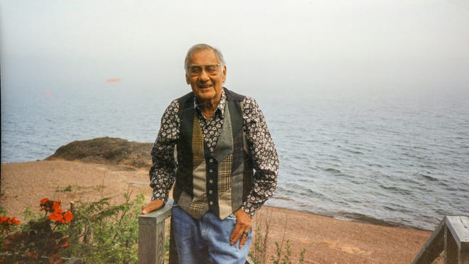 """Portrait of George Morrison on the deck of his home overlooking Lake Superior, date unknown. Part of the exhibit """"Modern Spirit: The Art of George Morrison"""" at Heard Museum."""