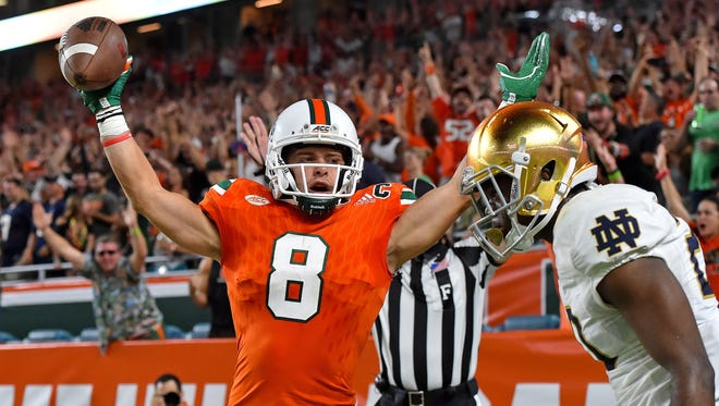 Miami Hurricanes wide receiver Braxton Berrios (8) celebrates his touchdown against the Notre Dame Fighting Irish during the first half at Hard Rock Stadium.