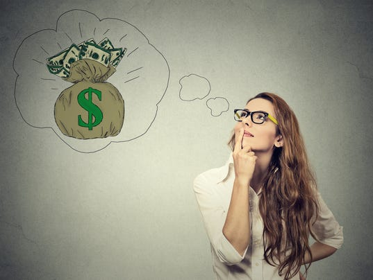 MSUFCU_Woman dreaming of financial success