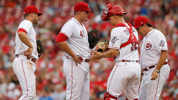Cincinnati Reds starting pitcher Sal Romano (47) is
