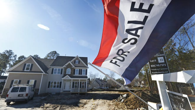 A newly built home for sale flaps in the breeze in Richmond, Va., on Jan. 8, 2015.
