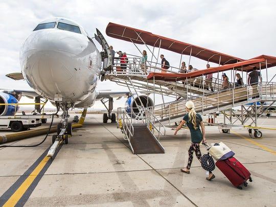 Passengers board an  Allegiant Airlines flight at Phoenix-Mesa
