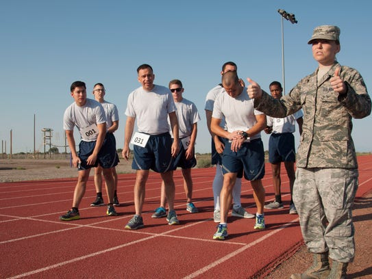 An Airman from the 49th Maintenance Group gives a thumbs
