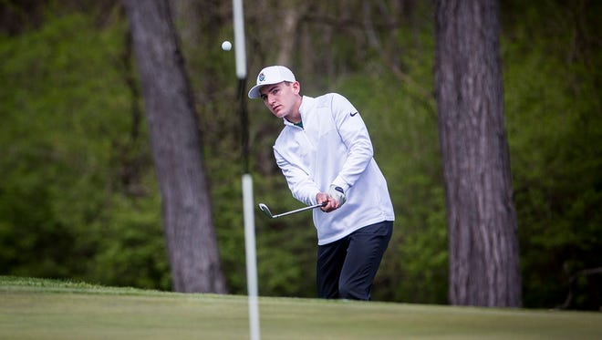 Yorktown's Brennan Baize competes in the county golf tournament at Muncie Elks Golf Club Saturday, April 28, 2018.