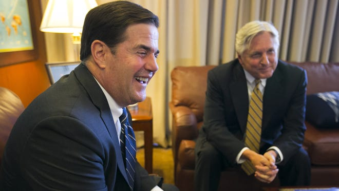 Gov. Doug Ducey, left, and Fred DuVal, who ran against him as the Democratic nominee for governor, are both appear in a commercial together for Proposition 123.