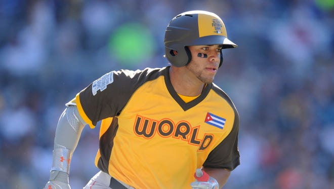 Yoan Moncada hit the go-ahead home run for the World Team in the eighth inning.