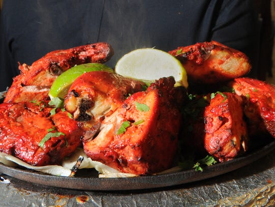 Chicken Tandoori Sizzler is served at The Masala Twist,