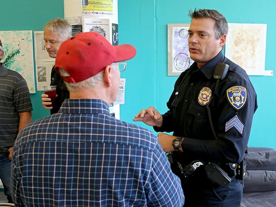 In this file photo, Sgt. Harold McClure with the Wichita Falls Police Department (right) talks with a citizen at the Odd Duck Coffee, 717 Seventh St., during Coffee with a Cop. The downtown coffee shop will have trick-or-treat festivities on Halloween.