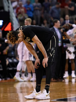Vanderbilt Commodores guard Matthew Fisher-Davis (5) reacts following the 68-66 loss against the Northwestern Wildcats in the first round of the NCAA tournament at Vivint Smart Home Arena.