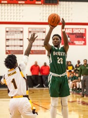 New Haven freshman Romeo Weems takes a shot during a quarterfinal basketball game Tuesday, March 22, 2016 at Lakeshore High School in St. Clair Shores.