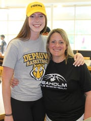 Seaholm's girls basketball standout Dana Hoerman (left), who will attend DePauw University in Indiana, poses with head coach January Hladki following a signing ceremony Tuesday afternoon.