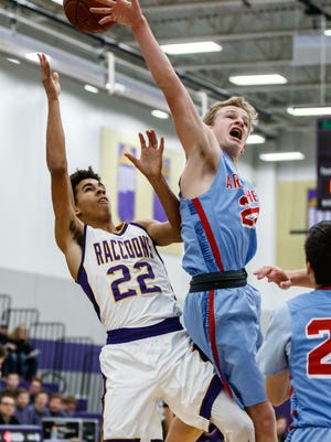 Oconomowoc senior Cameron Briggs (left) has his shot blocked by Arrowhead's Tyler Gouin during the game at Oconomowoc on Friday, Dec. 8, 2017.