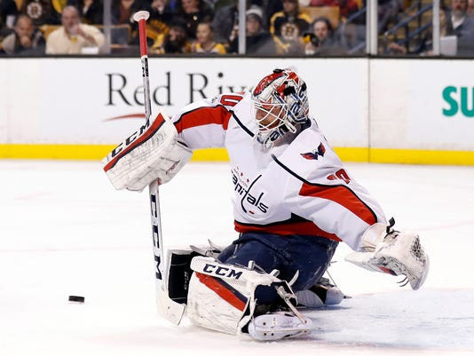 Washington Capitals goalie Braden Holtby makes a save during the second period of their 5-3 win over the Boston Bruins in an NHL hockey game in Boston Thursday, Dec. 14, 2017. (AP Photo/Winslow Townson)