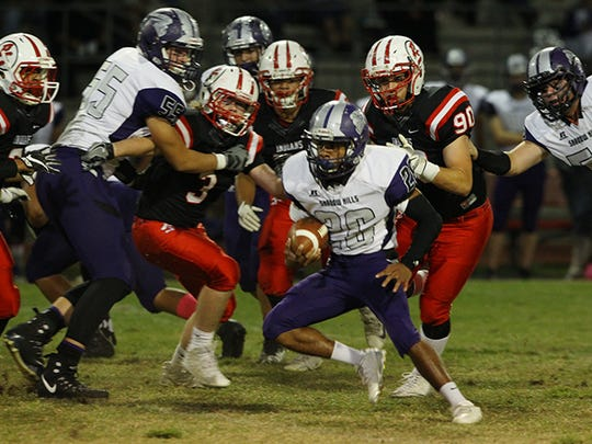 Shadow Hills junior Lee Hawkins looks to avoid defenders during a win against Palm Springs.