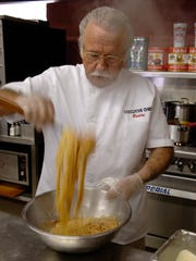 LAROSA. BUSINESS. NOVEMBER 7, 2005. Buddy LaRosa, founder of LaRosa's, a chain of Italian family restaurants, prepares spaghetti in the firm's test kitchen in Westwood Monday November 7, 2005. The Enquirer/Gary Landers