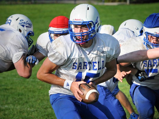 Sartell's Brandon Snoberger gets ready for a hand-off during practice Wednesday, Aug. 20 in Sartell.