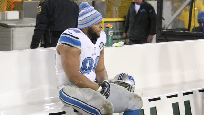 Detroit Lions Ndamukong Suh sits on the bench during the final seconds of the 30-20 loss to the Green Bay Packers on Sunday.