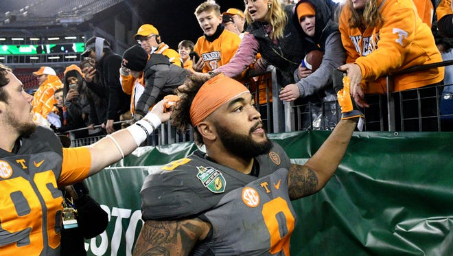 Tennessee Volunteers defensive end Derek Barnett (9) greets fans at the end of the Franklin American Mortgage Music City Bowl at Nissan Stadium in Nashville, Tenn., Friday, Dec. 30, 2016. Tennessee won 38-24.