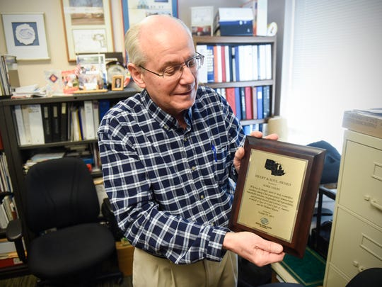 Boys & Girls Clubs Director Mark Sakry holds an award he received from the national organization during an interview in his office Tuesday, Jan. 16, in St. Cloud.