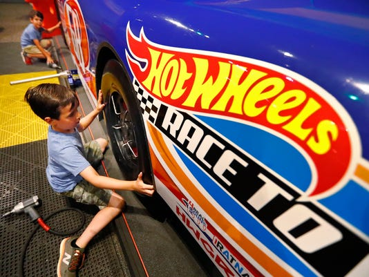 Local family takes Hot Wheels around world in memory of a Carmel boy who died with brain cancer.