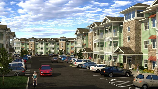 A rendering of what the three-story apartment buildings will look like in Willoughby Estates, a $38.5 million apartment complex being built along WIlloughby Road in Holt.