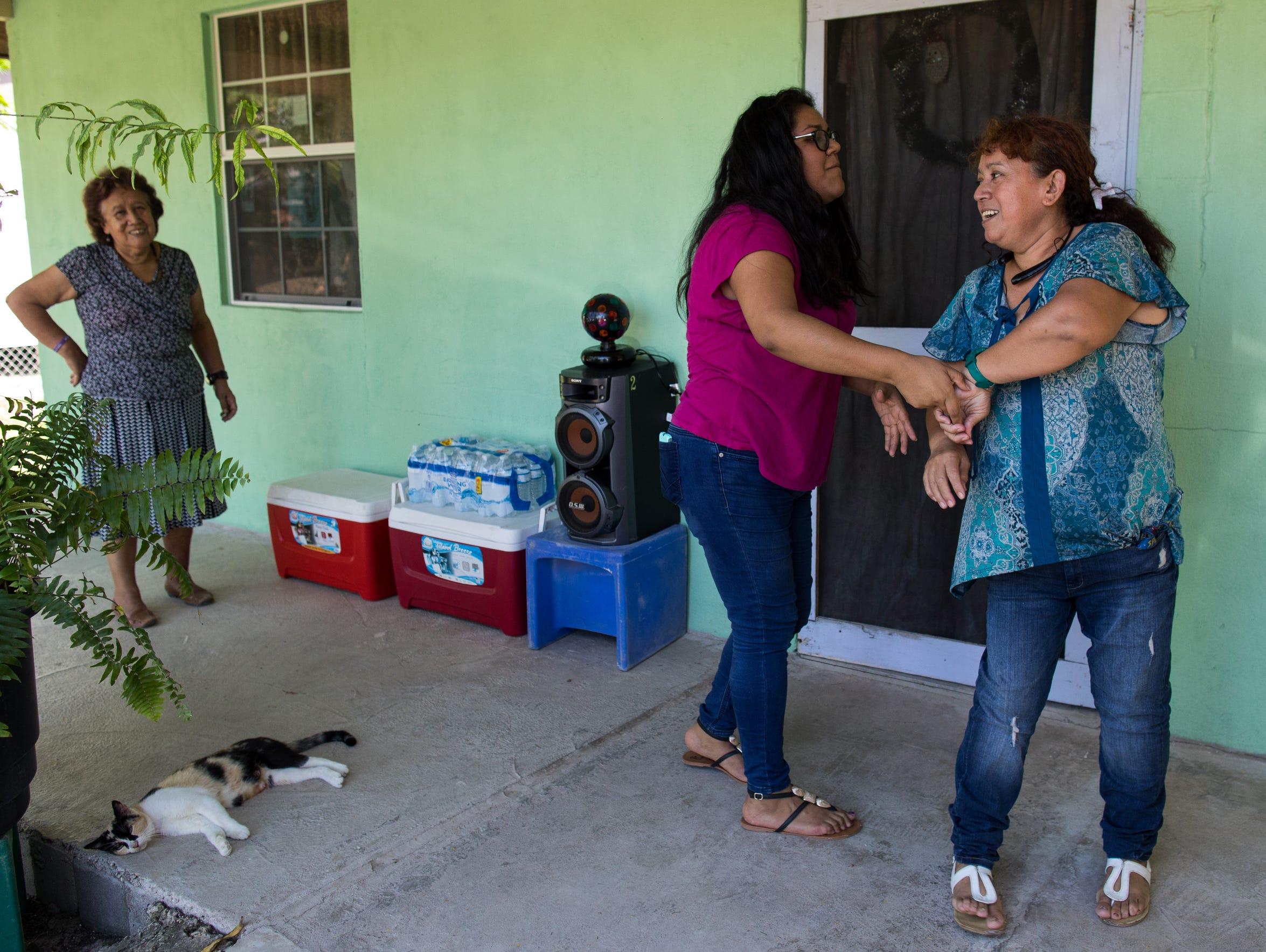 Maria Hernandez dances with her mother Carlota Palomo