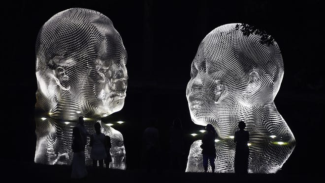 """Installed in the middle of Cheekwood's pond, Jaume Plensa's 'Awilda and Irma' sculptures light up as part of Cheekwood's """"Night Visions: Jaume Plensa Under the Stars.""""   During June and July, Cheekwood is open until 10pm on Thursdays."""