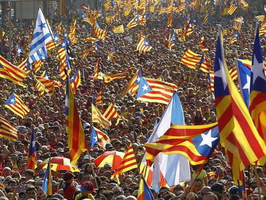People wave independence flags as they celebrate Catalonia National Day on Sept. 11in Barcelona, Spain. Red and yellow flags filled the streets as Catalan nationalists rallied to demand a vote on breaking away from Spain.