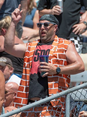 IndyCar fans in their best Carb Day attire during the Verizon IndyCar Series Pit Stop Challenge during Carb Day at the Indianapolis Motor Speedway on Friday, May 25, 2018.