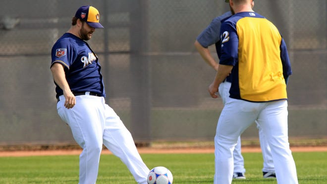 Milwaukee Brewers pitchers Matt Albers (left) and Jimmy Nelson go through drills to help with their footwork on Saturday.